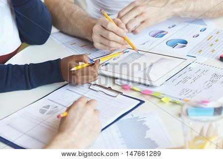 Business And Finances Concept. Hands Of Office Workers Holding Yellow Pencils, Making Financial Repo