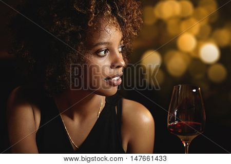 Profile Of Beautiful African Woman With Stylish Curlly Hair Wearing Elegant Black Dress, Enjoying Re