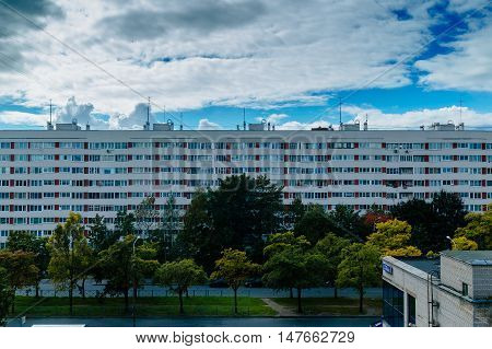 Multi-storey residential buildings, sleeping area. movement of clouds on a background of urban buildings.