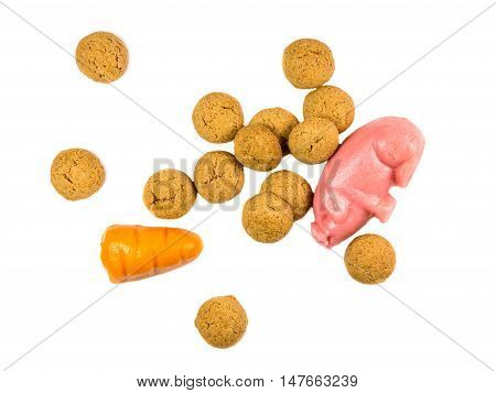 Handful Of Pepernoten Cookies With Marzipan Pig And Carrot