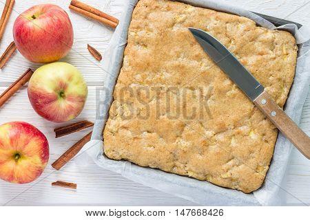 Homemade blondie (blonde) brownies apple cake in baking dish horizontal top view