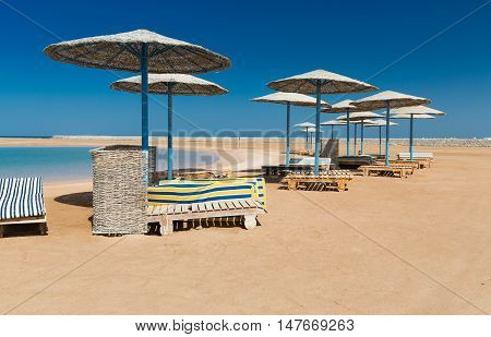 Sunshade Umbrellas on the beach at summer day