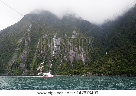 Milford Sound, New Zealand - February 2016: Tourist Boat Cruises In The Fjord Of Milford Sound, Sout