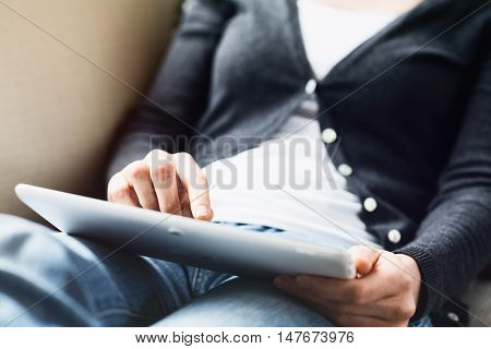 Woman Using A Tablet On Her Lap