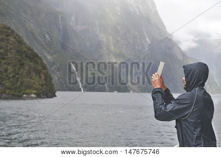 Milford Sound, New Zealand - February 2016: Tourist On Boat Cruises In The Fjord Of Milford Sound, S