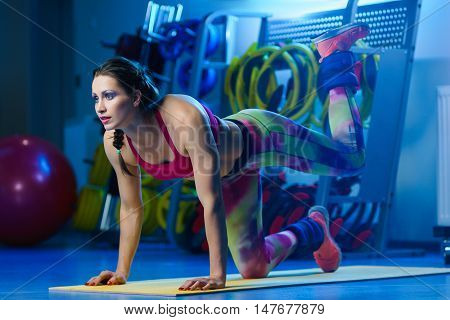 Powerful Attractive Muscular Woman Fitness Trainer W Orking Out