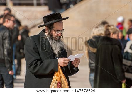 JERUSALEM ISRAEL - FEBRUARY 21 2012: Orthodox Jewish man near the Western Wall. Jerusalem. Israel