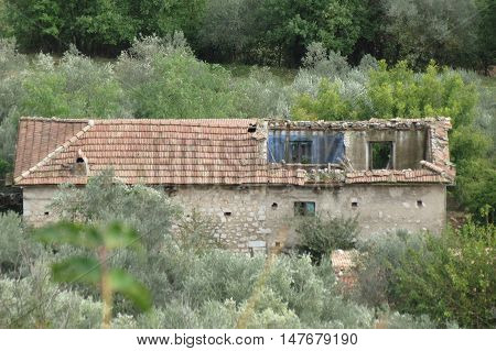 Ruined House With Roof Collapsed