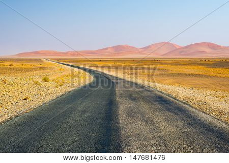 Road Crossing The Namib Desert, In The Wonderful Namib Naukluft National Park, Travel Destination In
