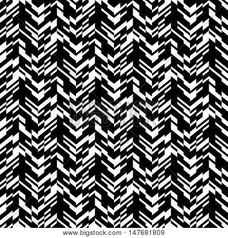 Vector geometric seamless chevron pattern with zigzag line and overlapping stripes in black and white. Striped bold print in hipster style for winter fall fashion. Abstract monochrome tech background