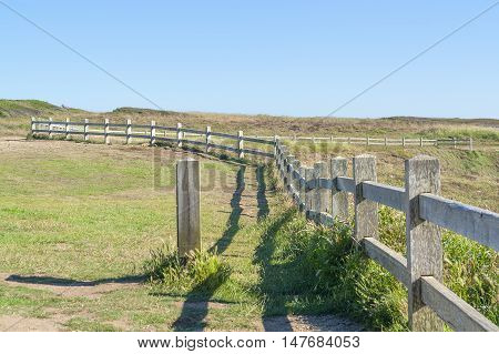 coastal scenery including a wooden fence around Pointe du Van a promontory in Brittany France