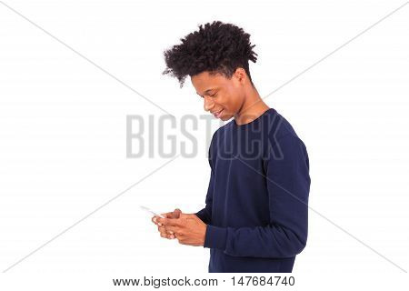 Young African American Man Sending A Sms Text Message On His Smartphone - Black Teenager People