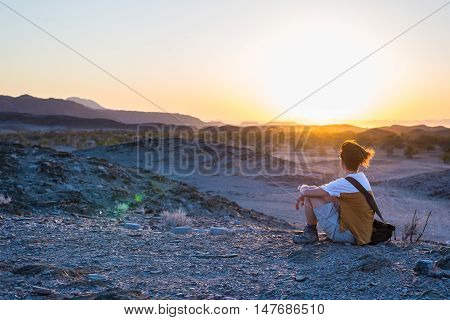 Tourist Watching The Stunning View Of Barren Valley And Mountains In The Namib Desert, Among The Mos