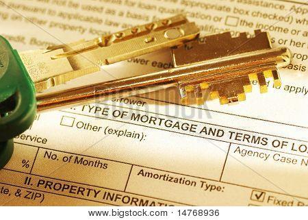 Mortgage application & keys. Shallow depth of field. Toned warm.