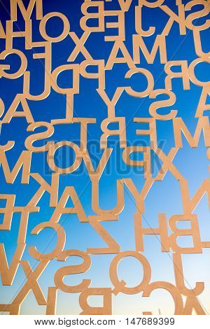 Antibes, France - June 14, 2016: Letters on the sky background. Fragment of the sculpture called Nomade in Antibes village. This sculpture is a creation by contemporary Catalan artist Jaume Plensa.