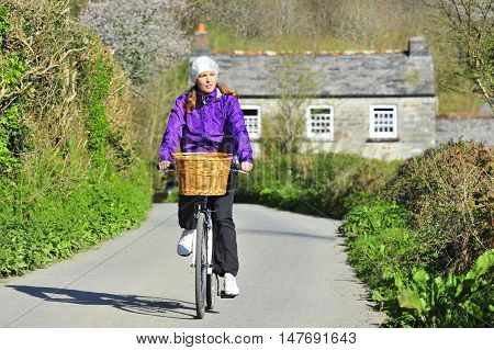 Young woman bicycling on a sunny spring day