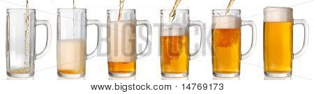 Beer mug isolated on white. Pouring beer in it. 43 Mpxls.