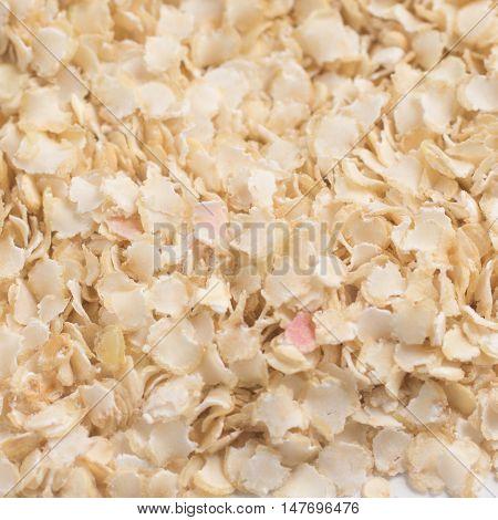 Close up on a Raw Quinoa Flakes