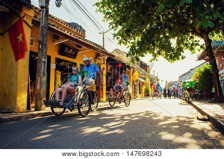Hoi An, Vietnam - September 02, 2013: The tourists are going around in the street by cyclos