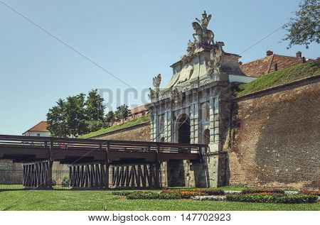Alba Iulia, Romania - July 24, 2016: Third gate of Alba Carolina Citadel the largest gate of the seven gates of the fortification dominated by an equestrian statue of emperor Carol VI of Austria.