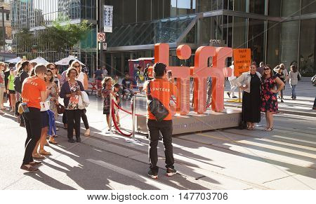 TORONTO - SEPTEMBER 15 2016: The TIFF or Toronto International Film Festival draws many people to watch premiere movie screenings and to be star gazing famous film stars.