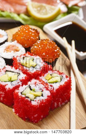Rolls with tobiko, avocado and cucumber still-life