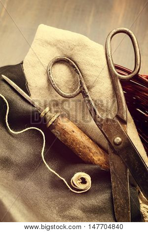 Old scissors and awl for leathercraft vintage still-life