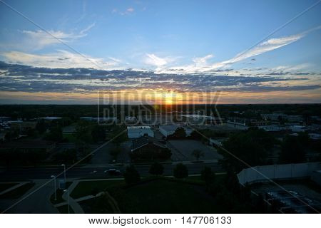 JOLIET, ILLINOIS / UNITED STATES - SEPTEMBER 3, 2016: A view of the sunset on the west side of Joliet, Illinois.