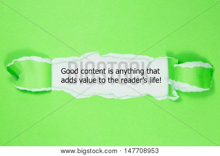 he quote Good content is anything that adds value to the readers life, appearing behind torn paper.