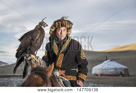 Bayan Ulgii Mongolia September 30th 2015: Portrait of a Mongolian eagle hunter with his eagle