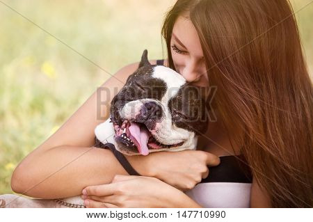 Young Girl Kissing Her Dog