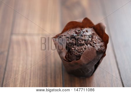 Sweet Chocolate Muffin On Wooden Table
