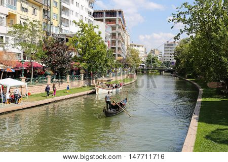 ESKISEHIR TURKEY - SEPTEMBER 03 2016: Gondola tours in Porsuk river. Porsuk river is one of the most populer touristy place with boat tours and entertainment in Eskisehir.