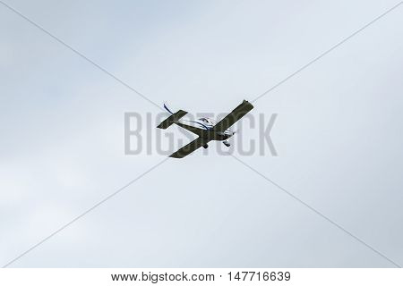 Private plane in the sky on a summer day