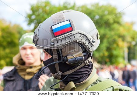 SAMARA RUSSIA - SEPTEMBER 11 2016: Unidentified member of military club in camouflage army uniform and helmet during military reenacting in Samara Russia