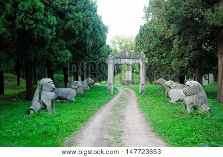 Traditional animal statues and dirt road through Confucius Family Cemetery in the city of Qufu located in Shandong Province China.