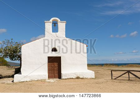 Posada - Church of Saint Lucia Posada. North Sardinia. Small church with a single nave the white facade with the entry portal which is surmounted by a large belfry.