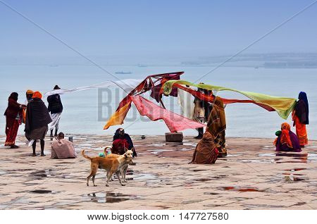 VARANASI, INDIA - JANUARY 13, 2010: Indian pilgrims dry their saris at Dashashwamedh Ghat.