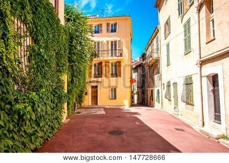 Beautiful residential buildings with colonial architecture in Cannes city in French riviera.