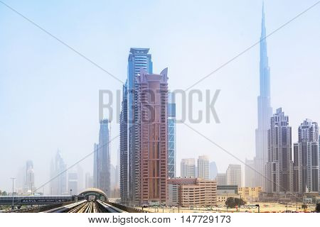 DUBAI, UAE - MARCH 31: Metro line in Dubai on March 31, 2014, UAE. The Dubai Metro is a driverless, fully automated metro rail network in the city of Dubai and carry over 180,000 passengers every day.