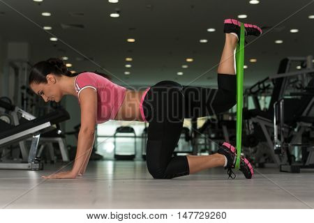 Attractive Woman Working Out With Rubber In Gym