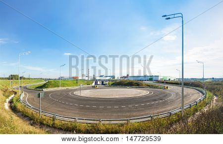 Panoramic view of an empty roundabout at sunny day.