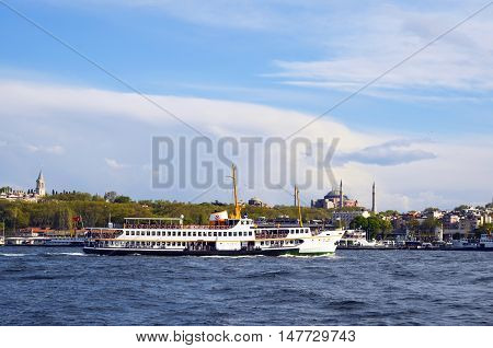 Istanbul Turkey - April 18 2014: Istanbul Ferry and Hagia Sophia Museum. Passenger ferry in Istanbul and it appears in the background Hagia Sophia Museum