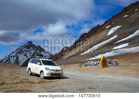 LACHULUNG LA, INDIA - JUNE 10: Vehicle driving in the Indian Himalayas across Lachulung La pass on June 10, 2012 in Ladakh, Jammu and Kashmir state, North India