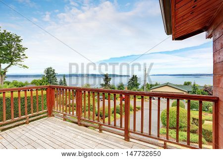 Unfurnished And Empty Balcony With Perfect Water View And Wooden Railings
