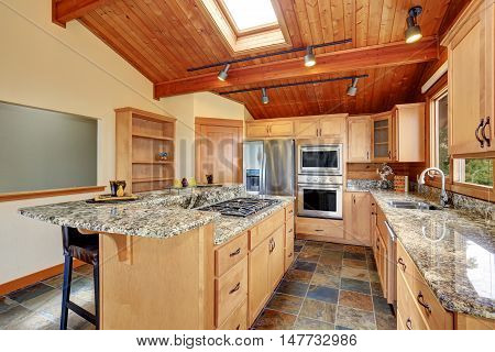 Wooden Trim Home With Open Floor Plan. Kitchen With Granite Counter Top.