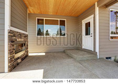 Backyard Concrete Floor Patio Area With Stone Fireplace