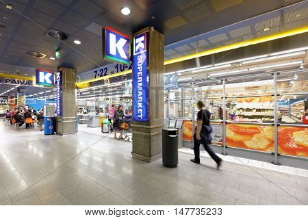 HELSINKI, FINLAND - AUGUST 21, 2016: People in the K-Supermarket in Kamppi center. Owned by Kesko company, the K-food store chains include  K-market, K-supermarket, K-citymarket and K-extra