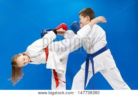 Roundhouse kick and punch arm are training children in the pair