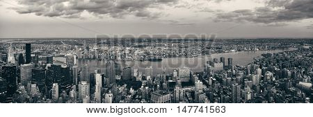 New York City Manhattan east side view panorama with skyscrapers and East River in black and white.